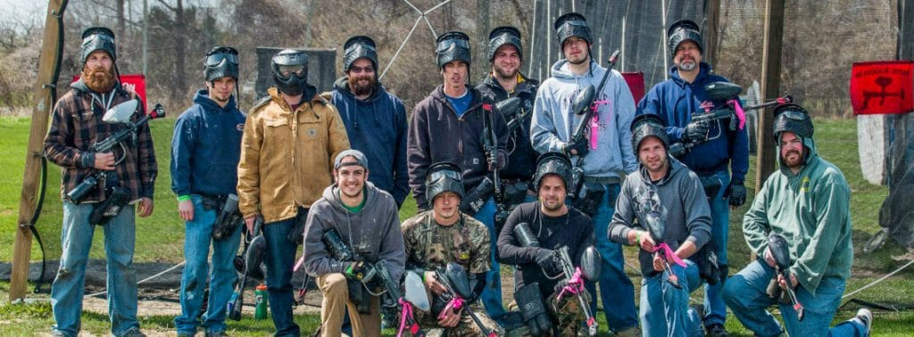 paintball team posing on a field